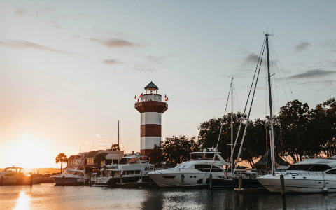 Hilton Head Island lighthouse marina boats sunset
